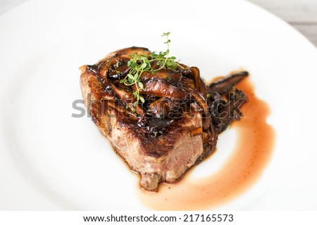Filet mignon steak with shiitake mushrooms - stock photo
