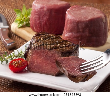 Filets, cooked and raw - stock photo