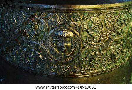 filigree on antique bell - stock photo