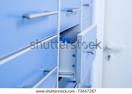 Filing cabinet with an open drawer - stock photo