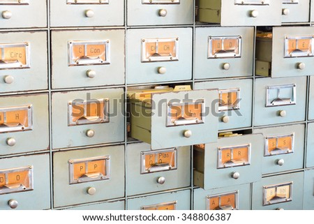 Filing cabinet with multiple open drawers. Office concept.  - stock photo
