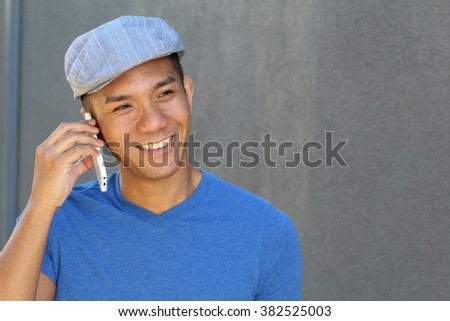 Filipino Businessman Outside Office On Mobile Phone - stock photo