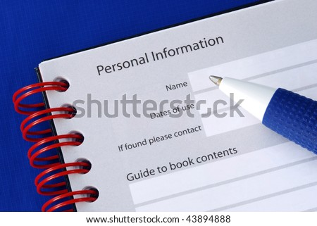 Fill in the personal information in the packet book - stock photo