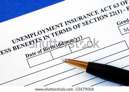 Fill out the application form for the unemployment insurance - stock photo