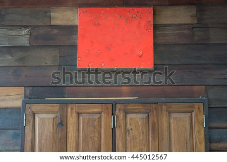 Fill text in red board on top of wooden door background - stock photo
