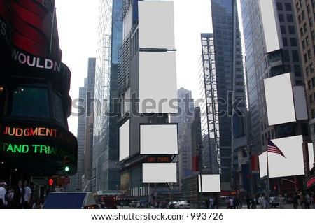 Fill this image of times square with anything you want in the blank advertising sign spaces - be creative.  Plenty of copy and negative space for your text or graphic designs. - stock photo