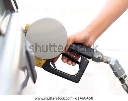 fill up fuel at gas station - stock photo
