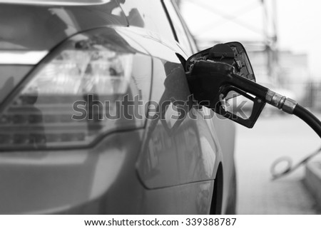 fill up with petrol - stock photo
