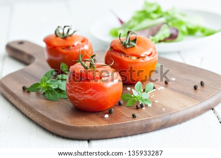 filled tomatoes with rice and onions - stock photo