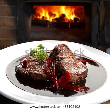 fillet mignon in red wine sauce with chili - stock photo