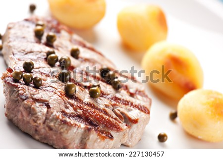 Fillet of beef with potateos - stock photo