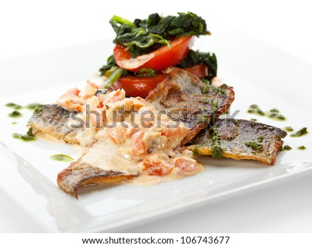 Fillet of Seabass with Tomato and Mussels Sauce - stock photo