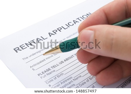 filling a rental agreement application - stock photo