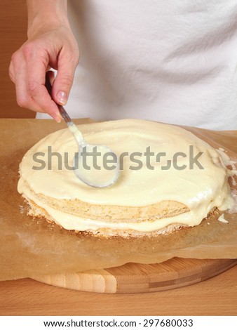 Filling cake layers. Making Chocolate Layer Cake with Cream Cheese Filling and Chocolate Topping. Series. - stock photo