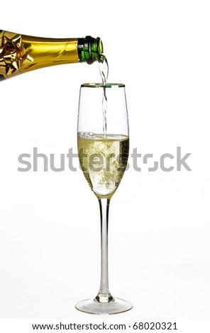 Filling champagne glass - stock photo