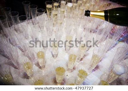Filling Champagne Glasses Ready For Reception - stock photo