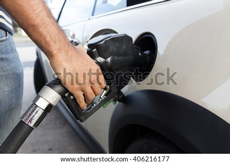 Filling gas at the station. Fill the gas tank. Self service. Gas pump in the car. Refill oil, gasoline, diesel vehicle - stock photo