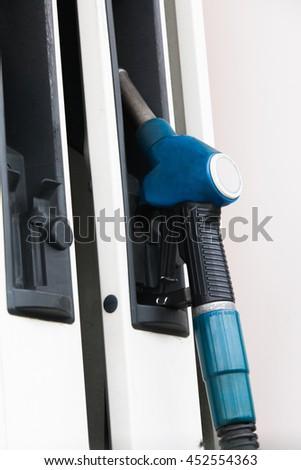 Filling gun at gas station - stock photo