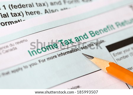 Filling in canadian individual tax form for year 2013 - stock photo