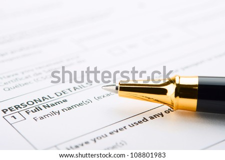 Filling of questionnaire a person by a ball point pen - stock photo
