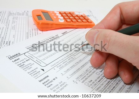 Filling out 1040EZ tax form - stock photo