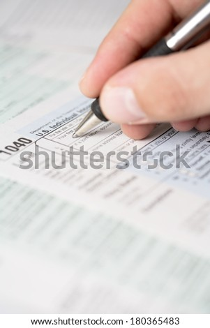 Filling out tax forms  - stock photo