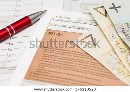 Filling polish tax forms  PIT-37 - stock photo