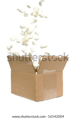 filling shipping peanuts in a box isolated against white background - stock photo