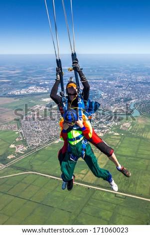 Filling tandem parachute. - stock photo