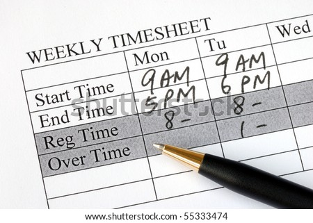 Filling the weekly time sheet for payroll - stock photo