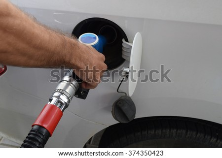 Filling with car gasoline - stock photo