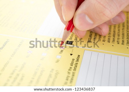 Filling Yes in checkbox of questionnaire - stock photo