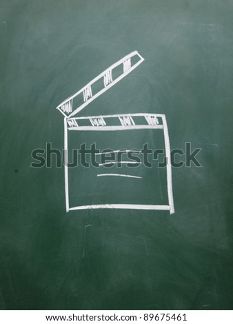 film clap board drawn with chalk on blackboard - stock photo
