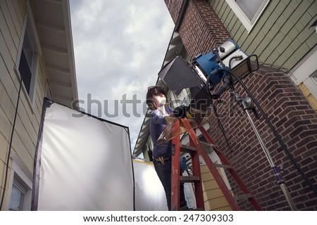 Film crew preparing set for film shoot - stock photo