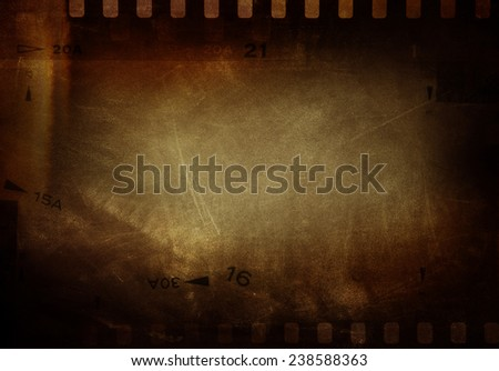 Film negative frames on brown background - stock photo