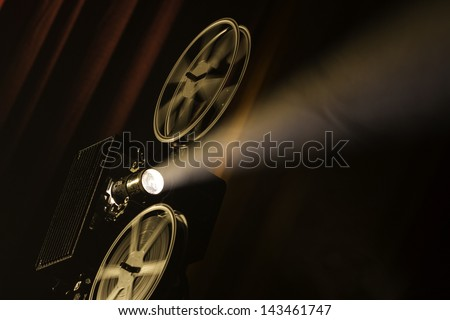 Film projector in smokey room. - stock photo