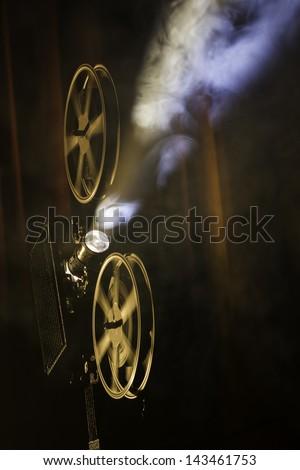 Film projector in smokey room. - stock photo
