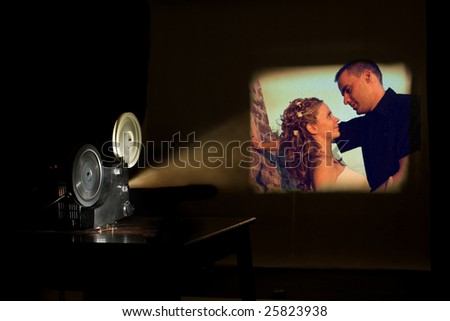 Film projector projecting a movie. Love couple on a screen. Film festival concept - stock photo