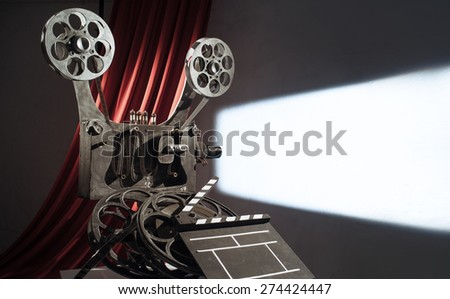 Film projector projecting a movie on the wall  - stock photo