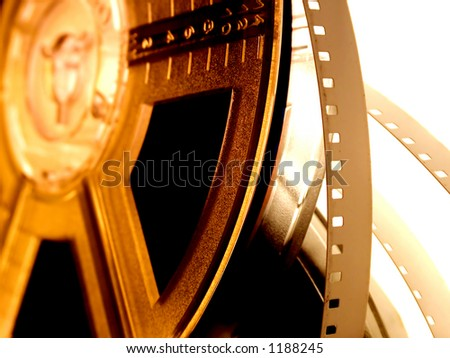 film reel isolated. Old movie reel on golden light - stock photo
