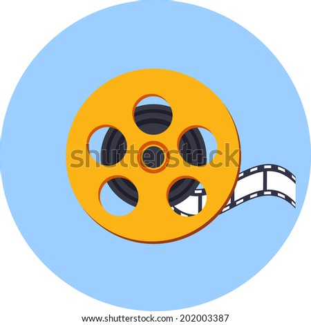 Film Reel with a Film Strip - stock photo