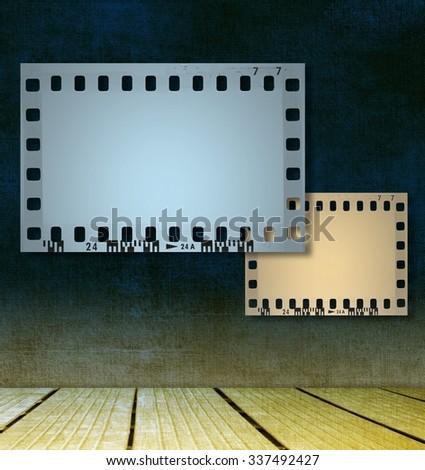 Film strip frames on room interior - stock photo