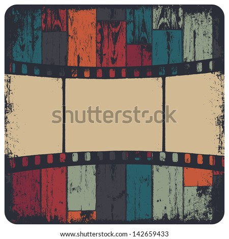Film strip in grunge frame on colorful seamless wooden background. Raster version, vector file available in portfolio. - stock photo