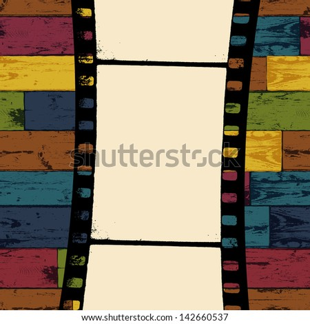 Film strip on colorful seamless wooden background. Raster version, vector file available in portfolio. - stock photo