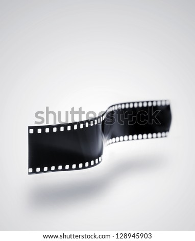 Film strip over plain background - stock photo