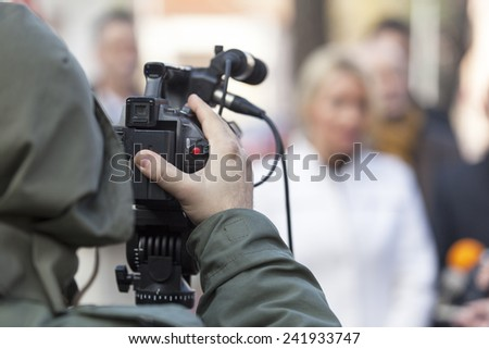 Filming an event with a video camera  - stock photo