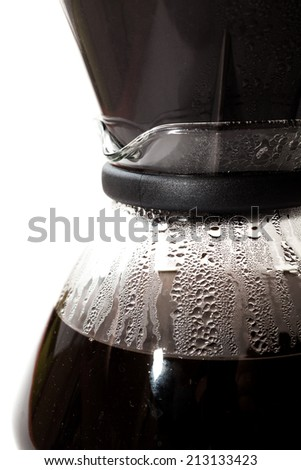 Filter coffee into a glass jug - stock photo