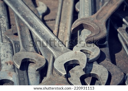 Filtered picture of loads of wrenches also called spanners - stock photo