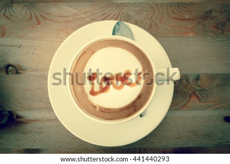 Filtered vintage tone A Latte Coffee art on the wooden desk.A cup of coffee,coffee Art. - stock photo