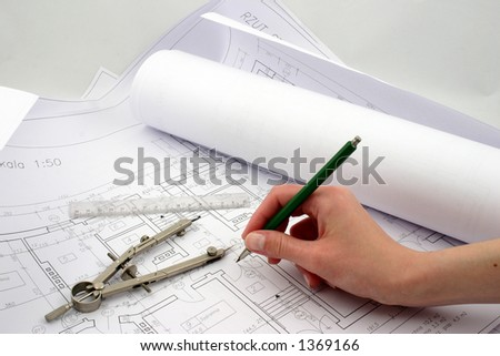 Final amendments on building designs with pencil, ruler - stock photo